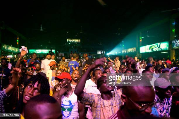 Afrobeat enthusiasts dance at the 'Afrika Shrine' dedicated to the pioneer of Afrobeat Fela Anikulapo Kuti during the annual Felabration Musical...