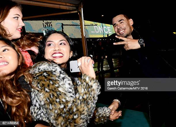 Afrojack poses for photos as he attends the MTV Europe Music Awards 2016 on November 6 2016 in Rotterdam Netherlands
