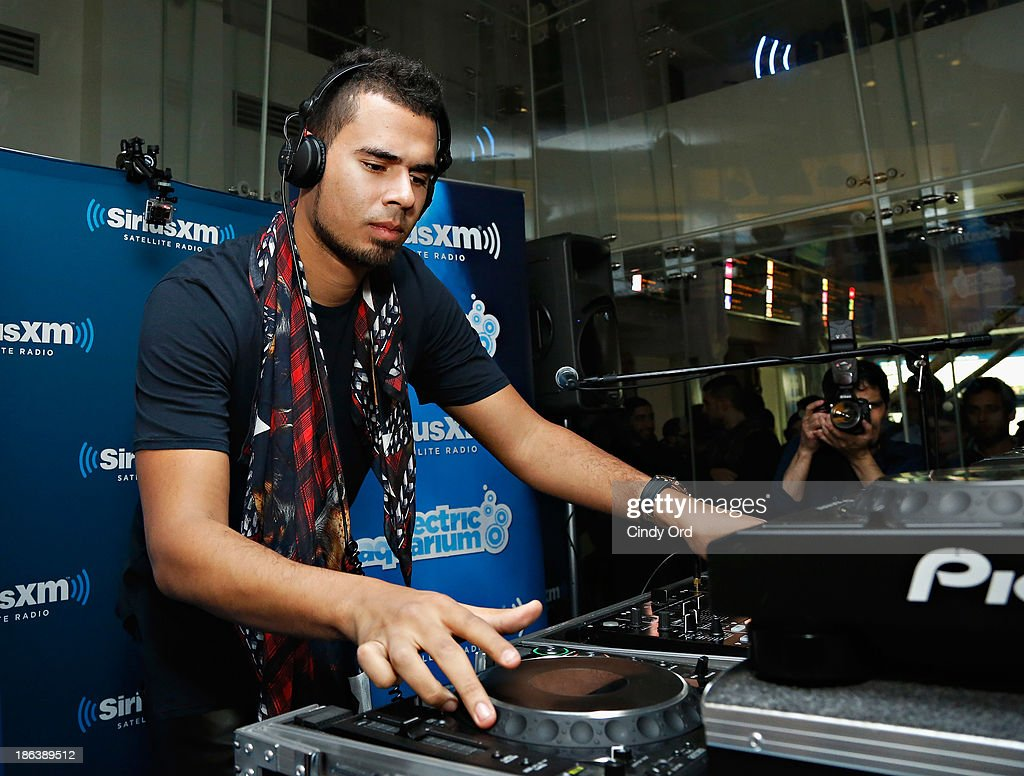 DJ <a gi-track='captionPersonalityLinkClicked' href=/galleries/search?phrase=Afrojack&family=editorial&specificpeople=7173108 ng-click='$event.stopPropagation()'>Afrojack</a> spins for an audience during SiriusXM's 'Electric Aquarium' Series on Electric Area at the SiriusXM Studios on October 30, 2013 in New York City.