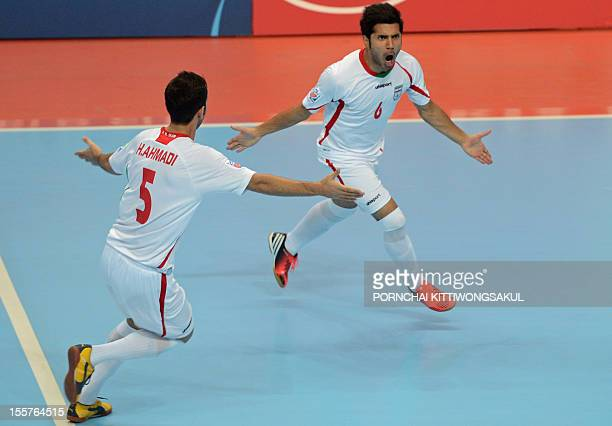 Afshin Kazemi of Iran celebrates with teammates after scoring a goal against Panama during their first round football match of the FIFA Futsal World...