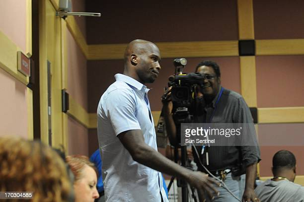 After a 15minutebreak former Miami Dolphins wide receiver Chad Johnson walks back into court after Broward Circuit Judge Kathleen McHugh rejected a...