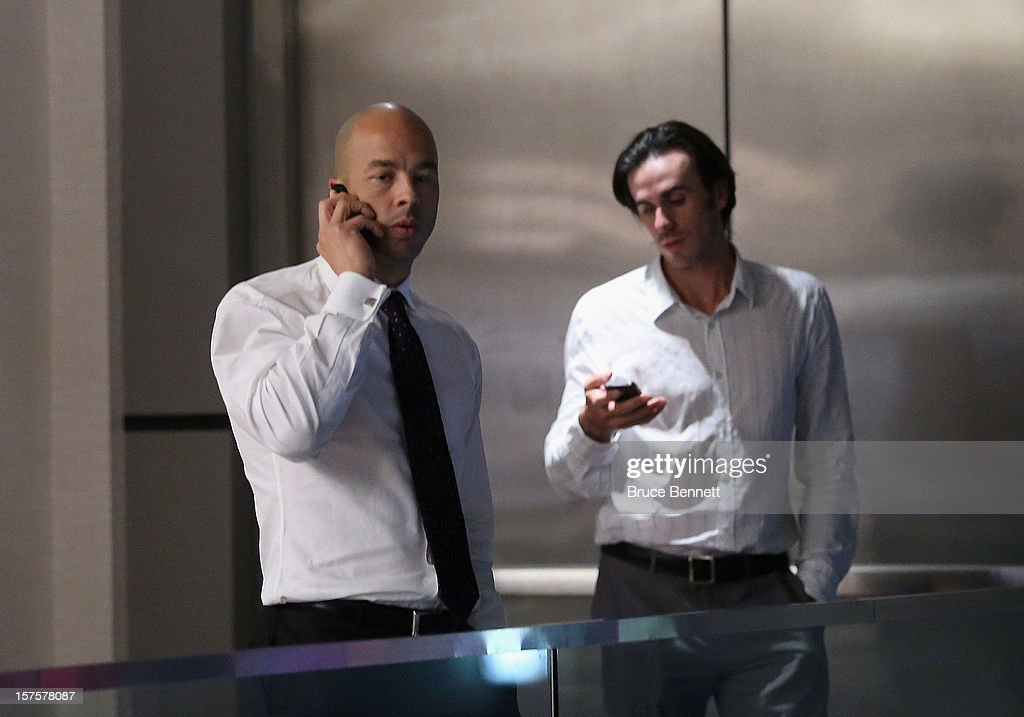 After a 5-1/2 hour negotiating session between the NHL and the Players Association, Manny Malhotra (L) and Ryan Miller (R) of the Buffalo Sabres make phone calls during the break at the Westin Times Square Hotel on December 4, 2012 in New York City.