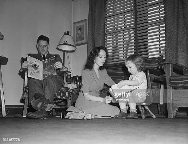 After a difficult day at school Mr Clark relaxes with a magazine while his wife tends to their daughter