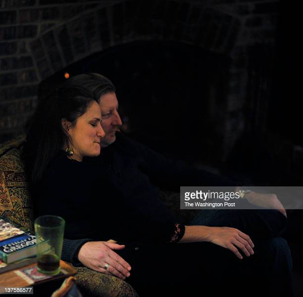 After a long day Jennifer Tidd gets some muchneeded cuddle time with her husband Don Tidd at home on January 19 in Reston VA 'I just don't think i...