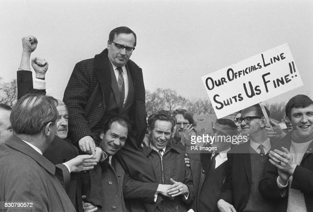 After a massive vote to stay out on strike some of the Ford workers in Basildon Essex carry Moss Evans Chairman of the union National Joint...