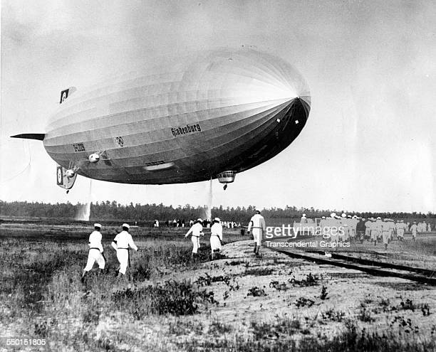 After a recordsetting crossAtlantic flight the zeppelin Hindenburg lands at the air field Lakehurst New Jersey June 22 1936 Approximately one year...