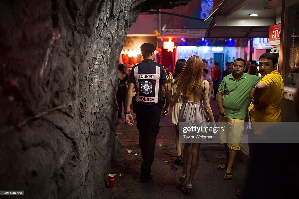 After a robbery is reported, Leo Oner, a member of FTPA, patrols Pattaya's Walking Street on July 31, 2014 in Pattaya, Thailand. Since 2002, members of the Foreign Tourist Police Assistants (FTPA) of Pattaya have been assisting local police on Walking Street, Pattaya's main nightlife area. Members of the FTPA carry handcuffs, batons, and pepper spray, and are charged primarily with assisting foreign visitors and the Thai police, as well as breaking up fights and catching thieves.