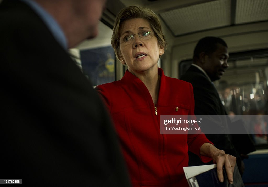 After a Senate Banking Committee hearing, Senators Mike Crapo (R-ID), left, and Senator Elizabeth Warren (D-MA) chat while on the Senate train on route to a Senate caucus luncheon in the Capitol on Capitol Hill Thursday, February 14, 2013.