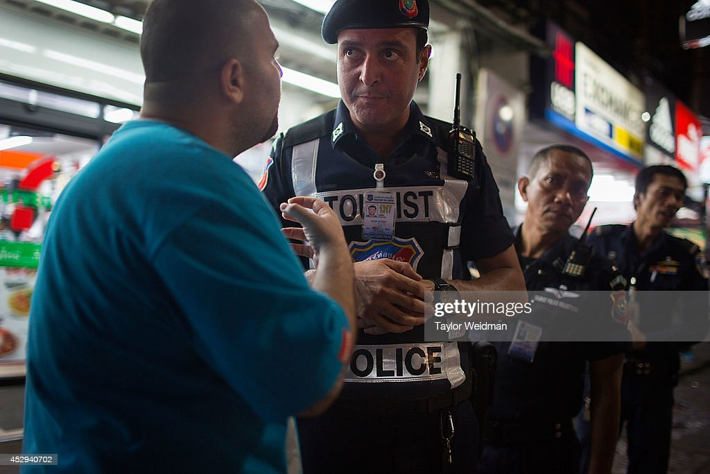 After a sexual assault is reported, Leo Oner, a member of the FTPA, interviews a witness on Pattaya's Walking Street on July 31, 2014 in Pattaya, Thailand. Since 2002, members of the Foreign Tourist Police Assistants (FTPA) of Pattaya have been assisting local police on Walking Street, Pattaya's main nightlife area. Members of the FTPA carry handcuffs, batons, and pepper spray, and are charged primarily with assisting foreign visitors and the Thai police, as well as breaking up fights and catching thieves.