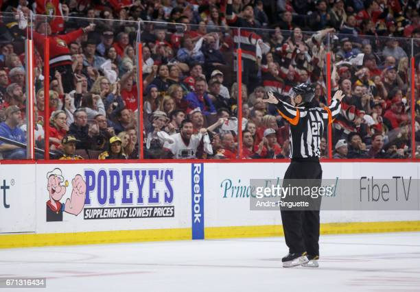 After a video review referee Chris Lee signals no goal during the first overtime period between the Ottawa Senators and the Boston Bruins in Game...