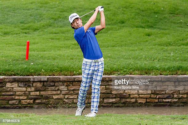 After a wayward tee shot and drop on leader Kevin Na hits his approach shot during the second round of the Crowne Plaza Invitational at Colonial in...