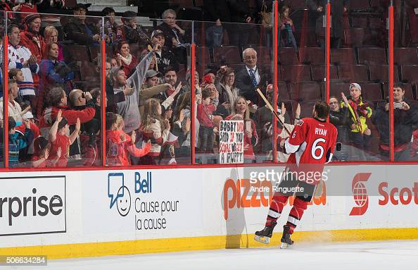 After a win against the New York Rangers Bobby Ryan of the Ottawa Senators gives a souvenir stick to the family who had a sign promising their son a...