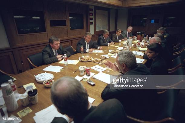 After addressing the nation Tuesday Sept 11 President George W Bush meets with his National Security Council in the Presidential Emergency Operations...