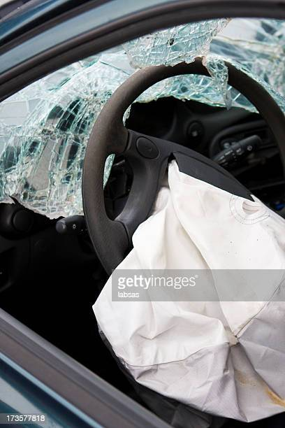 After affect of a car accident showing a deployed airbag