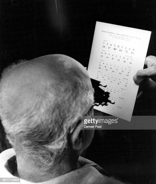 After being fitted with highpower convex lens Verne Rogers 81 and partially blind was able to read newspaper and Biblesize print for the first time...