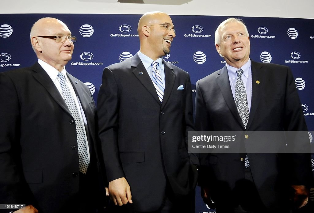 After being introduced as the new football coach, James Franklin laughs with Penn State athletic director Dave Joyner, left, and Penn State president Rodney Erickson, right, during a news conference at Beaver Stadium in University Park, Pa., on Saturday, Jan. 11, 2014.