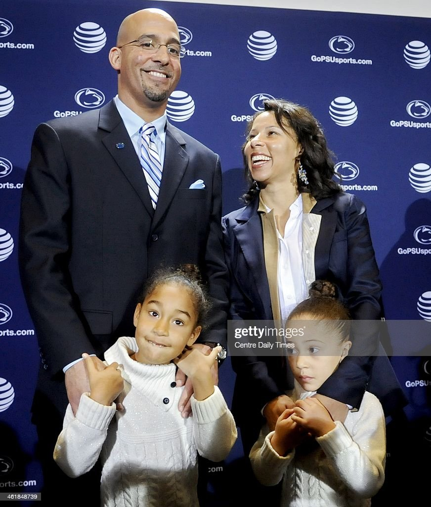 After being introduced as the new football coach, James Franklin stands with his wife Fumi, and their daughters Shola and Addison, during a news conference at Beaver Stadium in University Park, Pa., on Saturday, Jan. 11, 2014.