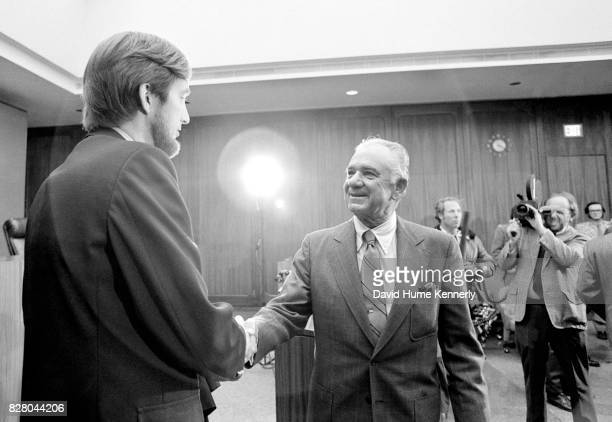 After being sworn in as Special Prosecutor Leon Jaworski shakes hands with an unidentified reporter on Capitol Hill Washington DC November 5 1973...