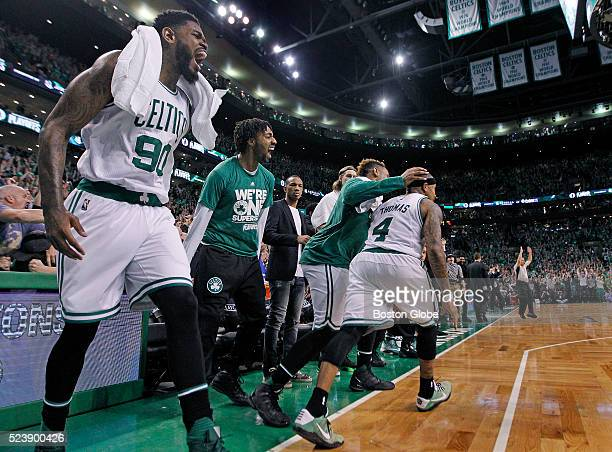 After Boston Celtics guard Isaiah Thomas center hit a three pointer from in front of the Celtics bench late in overtime his teammates erupt including...