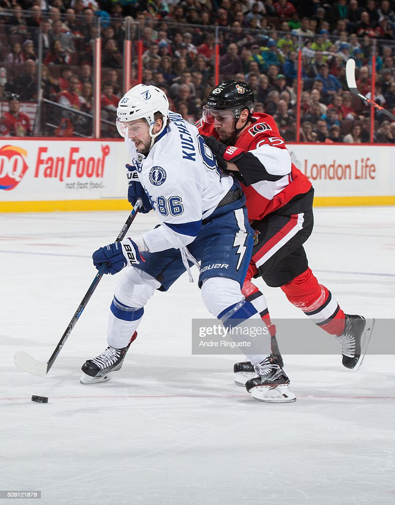 After breaking his stick, <a gi-track='captionPersonalityLinkClicked' href=/galleries/search?phrase=Erik+Karlsson&family=editorial&specificpeople=5370939 ng-click='$event.stopPropagation()'>Erik Karlsson</a> #65 of the Ottawa Senators chases down <a gi-track='captionPersonalityLinkClicked' href=/galleries/search?phrase=Nikita+Kucherov&family=editorial&specificpeople=7832285 ng-click='$event.stopPropagation()'>Nikita Kucherov</a> #86 of the Tampa Bay Lightning on a breakaway, taking away his scoring chance at Canadian Tire Centre on February 8, 2016 in Ottawa, Ontario, Canada.