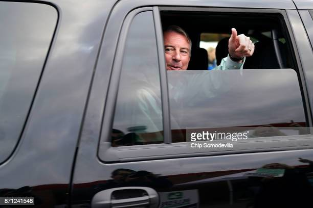 After casting his vote Republican candidate for Virginia governor Ed Gillespie gives supporters a thumbsup as he leaves Washington Mill Elementary...