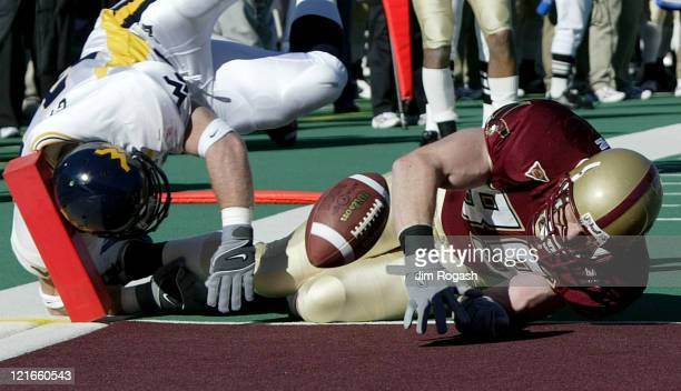After catching a pass to advance to the one yard line Boston College tight end Sean Ryan bottom is prevented from scoring by the defense of West...