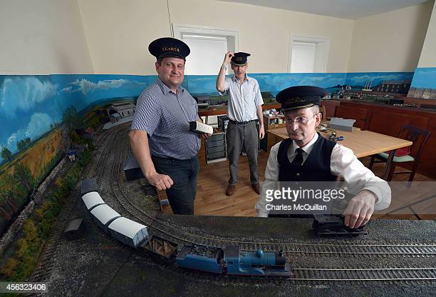 After closing the premises the owners of the Headhunters Barber Shop and Museum head upstairs to the loft to work on their model railway set on...