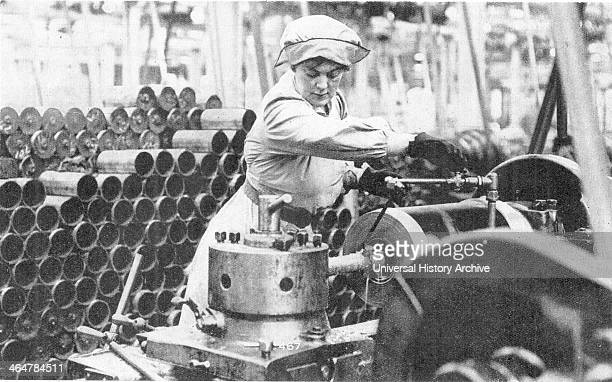 After conscription in 1916 women took over many civilian jobs British female munitions worker operating a lathe