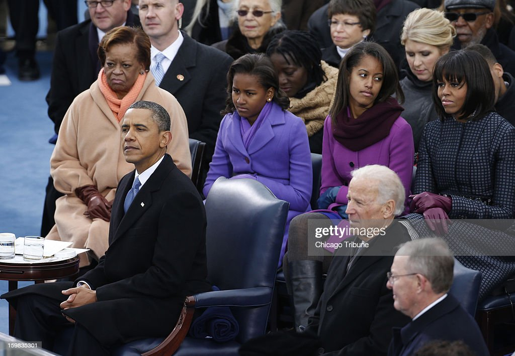 After delivering his inauguration speech, U.S. President Barack Obama listens to Kelly Clarkson during ceremonies on the West Front of the U.S Capitol in Washington, D.C., January 21, 2013.