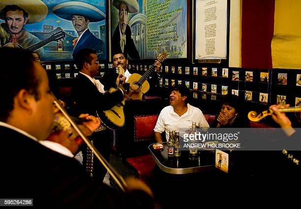 After drinking alcohol an inebriated man sings to the music of mariachis at the Salon Tenampa a bar that celebrates the giants of mariachi music The...