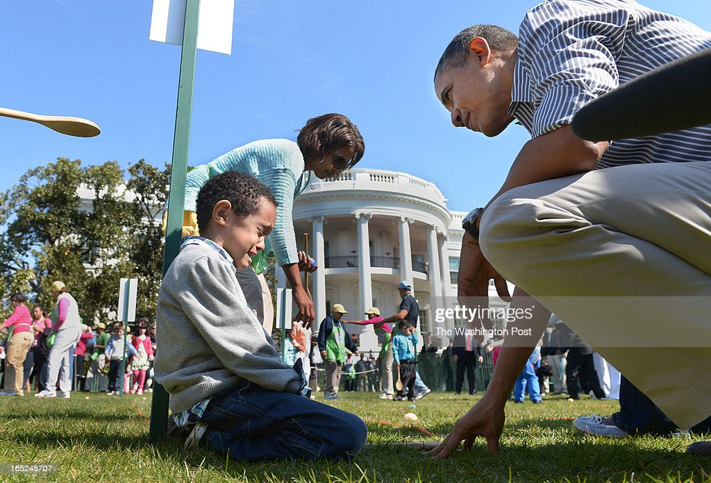 After finishing rolling an Easter egg Donovan Frazier is consoled by President Barack Obama at the annual White House Easter Egg Roll on Monday April...