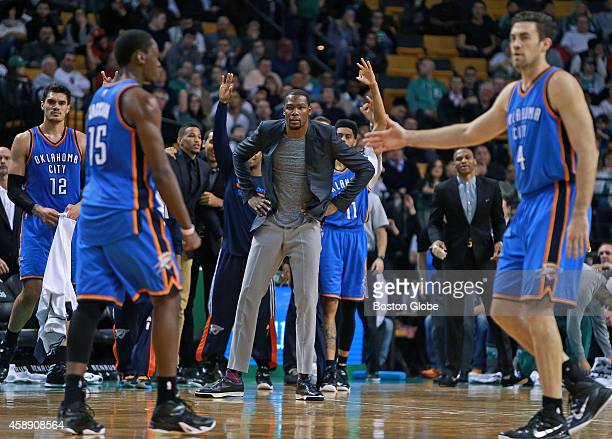 After former Boston College star Reggie Jackson left hit a buzzer beating threepointer to give the Thunder a 7672 lead he gets a hand from teammate...