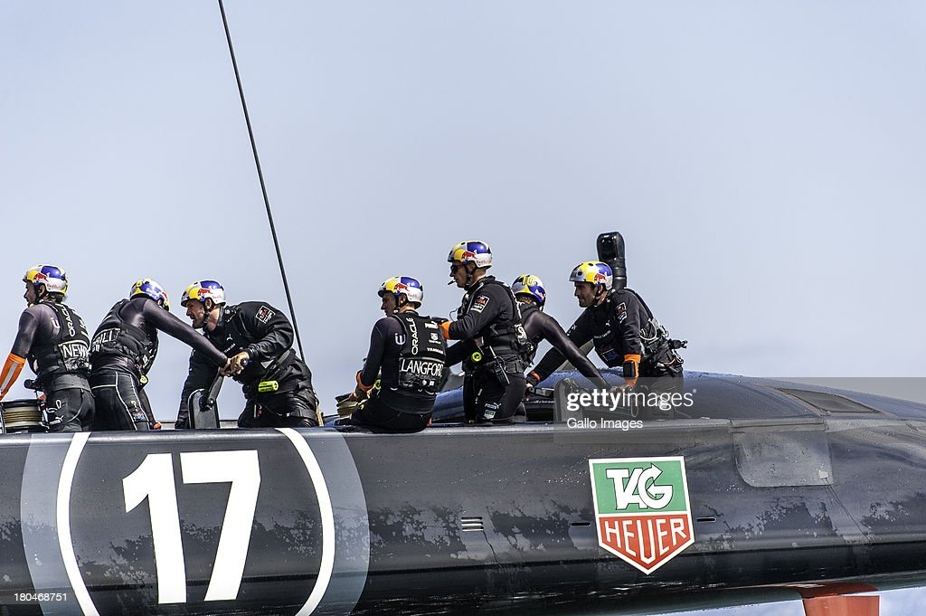 USA after guard with 4 x Olympic gold medallist Sir Ben Ainslie (GBR) at the very back of the boat during day 4 of the America's Cup on September 12th, 2013 in San Francisco.