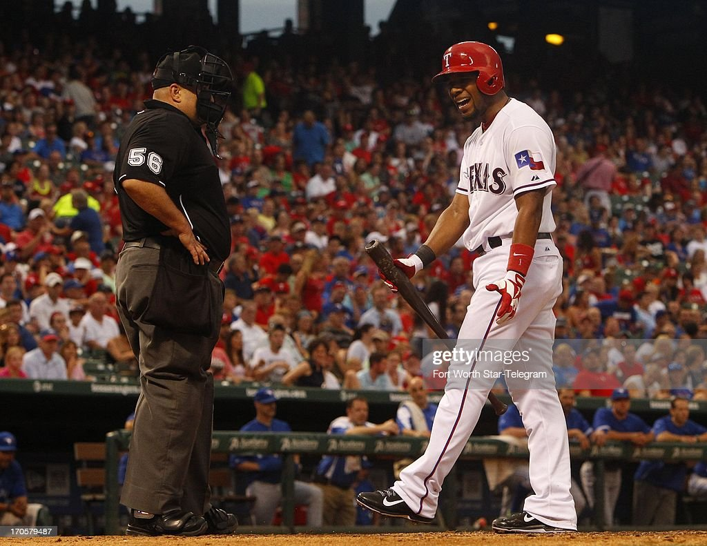 After he struck out looking, the Texas Rangers' Elvis Andrus objects to the call by home plate umpire Eric Cooper in the sixth inning against the Toronto Blue Jays at Rangers Ballpark in Arlington on Friday, June 14, 2013, in Arlington, Texas. Andrus was ejected.