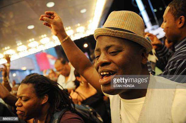 After hearing of the death of pop star Michael Jackson people gather and sing June 25 2009 in front of the Apollo Theater in the Harlem section of...