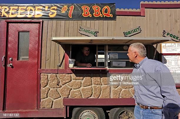 After his fifth stop which was at the Cornerstone Coffee shop in Akron Colorado Senatorial candidate Ken Buck stopped at a road side BBQ stand for...