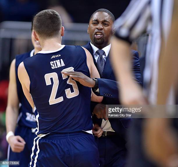 After his team erases a big deficit George Washington head coach Maurice Joseph gives a chest bump to Jaren Sina during the second half against UAB...