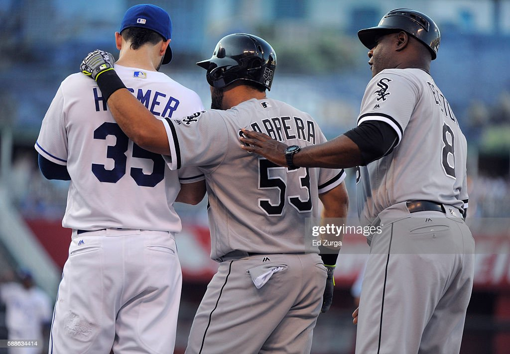 After hitting a single, Melky Cabrera #53 of the Chicago White Sox talks with Eric Hosmer #35 of the Kansas City Royals and first base coach Daryl Boston #8 of the Chicago White Sox in the first inning at Kauffman Stadium on August 11, 2016 in Kansas City, Missouri.