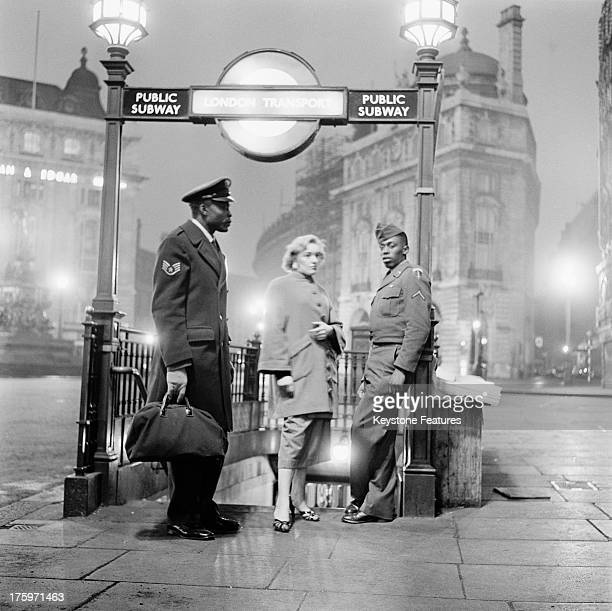 After leaving the 'Club Americana' a Saturday night jazz club open from midnight until 7 am American troops and their girlfriends wait at Piccadilly...