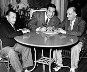 After losing to James Braddock Max Baer signs a contract with promotor Mike Jacobs to fight Joe Louis as Ancil Hoffman looks on in Long Beach New...