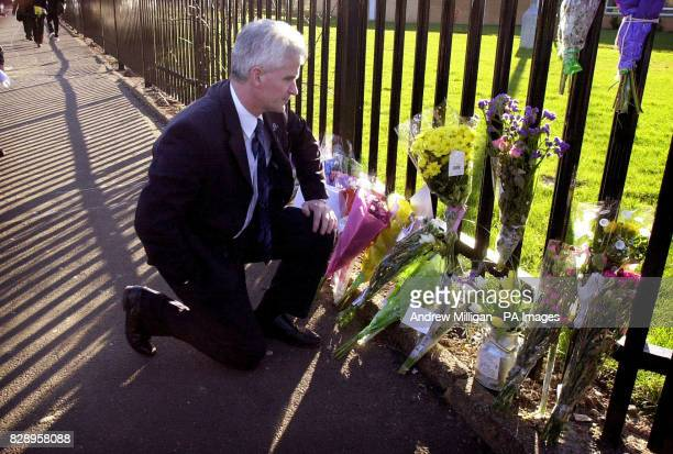 After making a statement Headteacher Tom McDonald views flowers left at the gates of All Saints RC Secondary School where an eleven year old died in...
