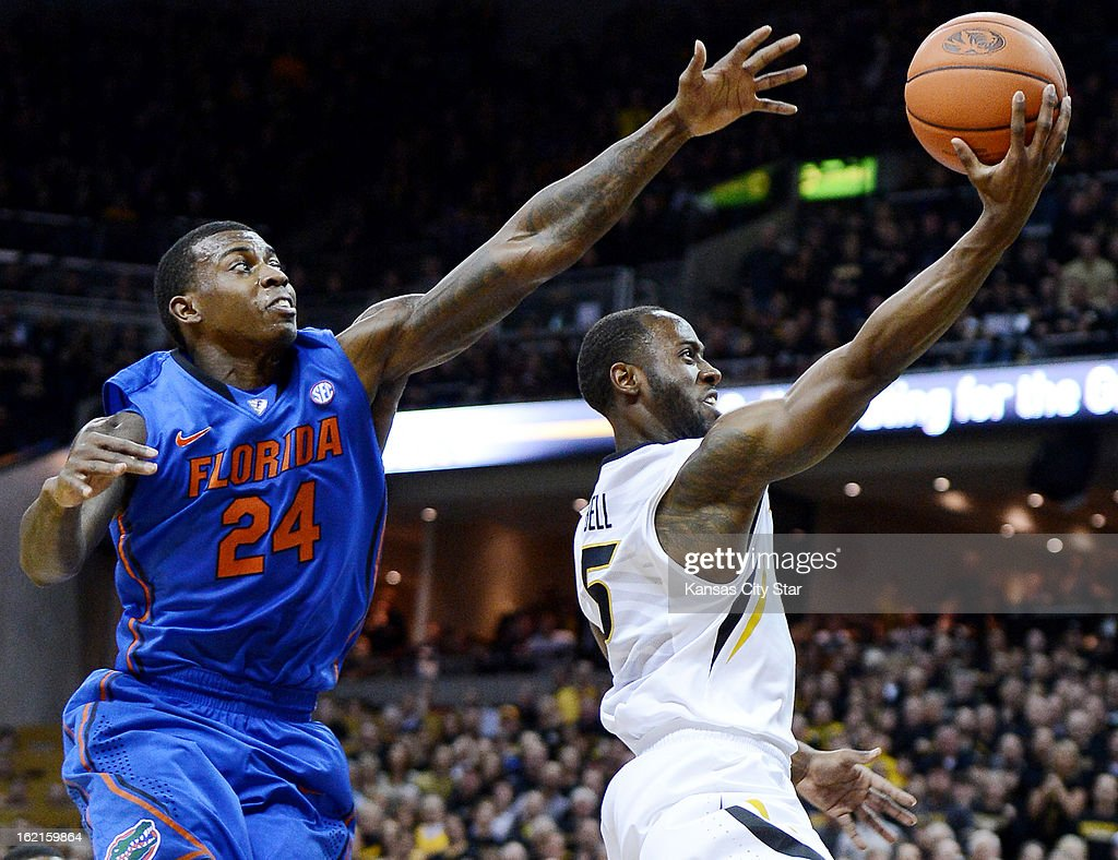 After making a steal on the defensive end of the floor, Missouri's Keon Bell streaks past Florida's Casey Prather for a bucket during the first half at Mizzou Arena in Columbia, Missouri, on Tuesday, February 19, 2013. Missouri rallied for a 63-60 win.