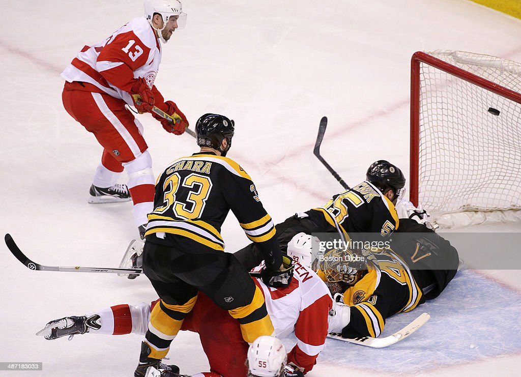 After making the initial save on a shot by Detroit Red Wings left wing Johan Franzen (#93), Detroit Red Wings center Pavel Datsyuk (#13) was able to score on the rebound for the power play goal that tied the game at 1-1 in the second period. The Boston Bruins host the Detroit Red Wings in Game Five of the first round of the NHL Stanley Cup playoffs at TD Garden on April 26, 2014.