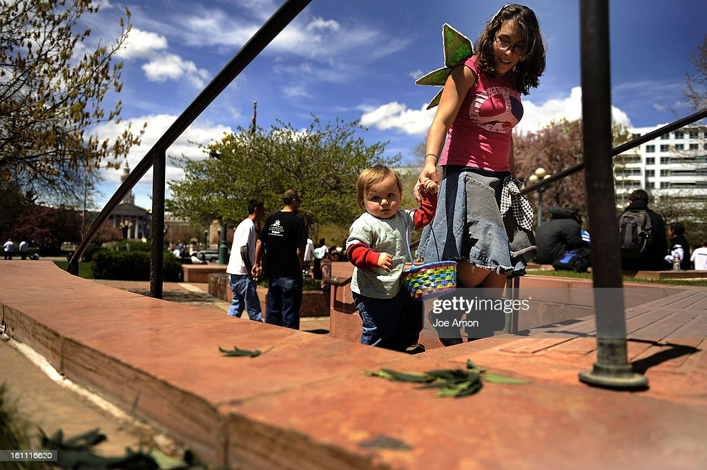 After marching through the streets of Denver to end the prohibition of marijuana Sarah Isfahani 21 walks her 1 year old son, Herb, around the veterans memorial near the Colorado State Capitol during the rally. Joe Amon, The Denver Post