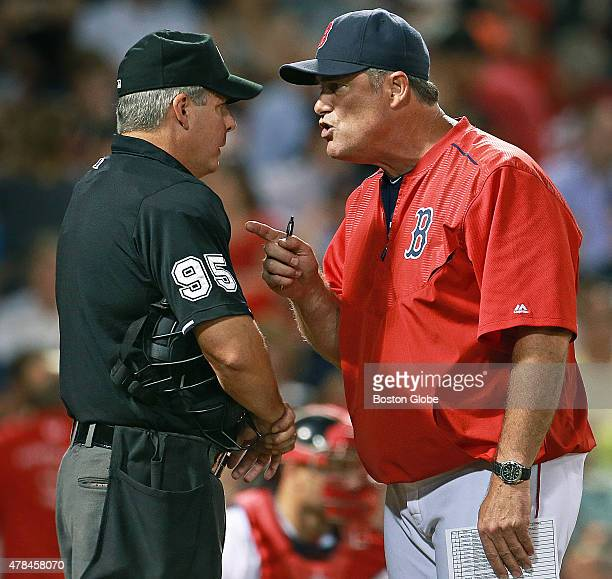After Mike Napoli and Brock Holt were both called out on strikes in the bottom of the sixth inning Red Sox manager John Farrell came out before the...