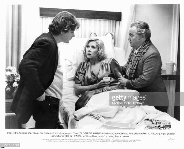 After one of her numerous suicide attempts Gloria Grahame is visited by her husband Kenneth McMillan and her son John Heard in a scene from the film...