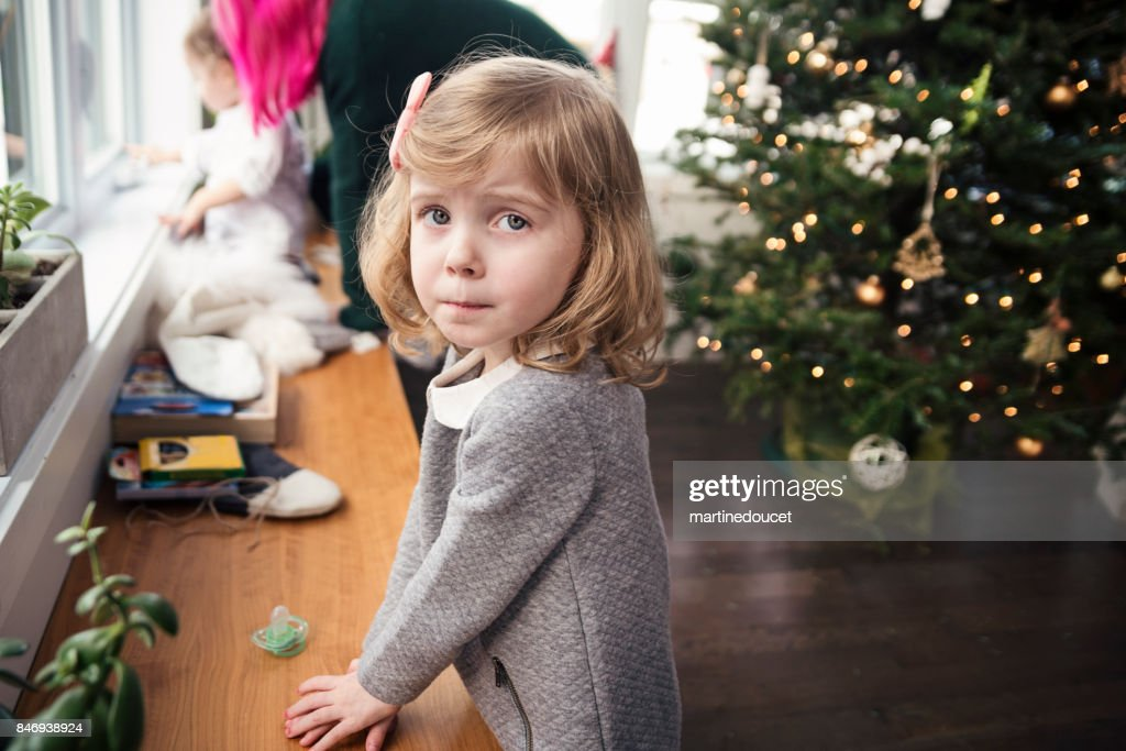 After opening gifts on Christmas morning for cute little girl. : Stock Photo