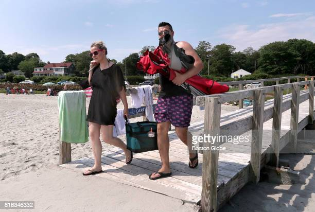 After parking at their 'secret spot' Ashley and Arthur Leite of Lynn cross the footbridge to the sands of Good Harbor Beach in Gloucester Mass July 1...
