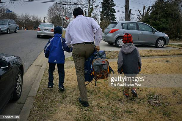 After parking his car Animesh Gupta walks his two children ages 5 and 7 to their school on Tuesday March 11 in Falls Church VA Homeowners in Fairfax...