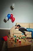 Tired or drunk man sleeping after party